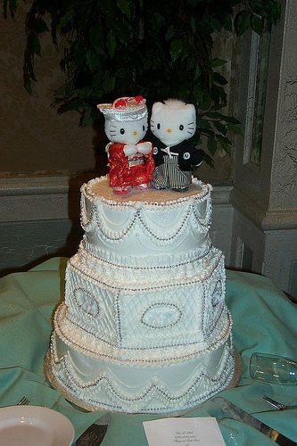 Beautiful Hello Kitty wedding cake topper. Figurines are hand-made in cold